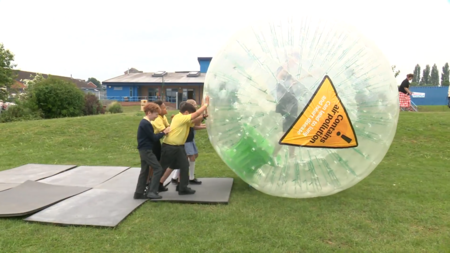 St James' CofE Primary School pupils playing with the CAReless Pollution Zorb-ball